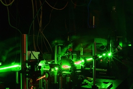 A new system to monitor radiation damage in a material creates acoustic oscillations by using two pulsed laser beams aimed at a sample, in such a way that the light waves of the two beams cause an interference pattern. This interference pattern causes heating at the sample surface, generating a standing acoustic wave. The motion of the surface caused by this wave can be monitored by another set of...