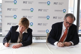 MIT's Maria T. Zuber and Conservation International's Peter Seligmann sign an agreement for a multiyear collaboration to develop and advance nature-based solutions to global climate change, through research, education, and outreach efforts.