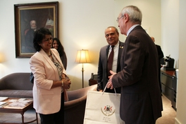 The president of Mauritius, Ameenah Gurib-Fakim (left), meets MIT President L. Rafael Reif (right), on Friday, April 7, at MIT. Sooroojdev Phokeer, the Mauritius ambassador to the U.S., stands in the background (center).