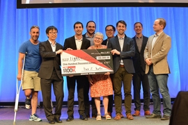 The winning team Lightmatter pose with organizers and friends.