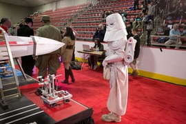 An Imperial Snowtrooper inspects a competitor's entry at the 2017 MIT Mechanical Engineering 2.007 Student Design Final Robot Competition.