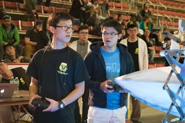 Sophomore ZhiYi Liang (left) and freshman second/driver Gabriel Li, (right) compete in the 2017 MIT Mechanical Engineering 2.007 Student Design Final Robot Competition. Liang would go on to place fourth in the competition.