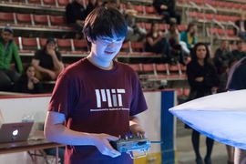 A student competes in the 2017 MIT Mechanical Engineering 2.007 Student Design Final Robot Competition.