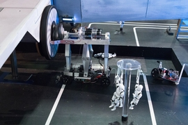 Sophomore Tom Frejowski's robot would help him go on to win the 2017 MIT Mechanical Engineering 2.007 Student Design Final Robot Competition. Here, the robot exerts enough torque during the autonomous period, a hands-free pre-programmed time, to rotate the X-Wing's lower thruster to it's maximum speed.