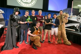 Left to right: Professor Amos Winter (as Darth Vader); Joshua Graves; 3rd place finisher Brandon McKenzie; 1st place winner Tom Frejowski (kneeling); 2nd place finisher Richerd Moyer; 4th place finisher ZhiYi Liang; Gabriel Li; and Professor Sangbae Kim (as Chewbacca).