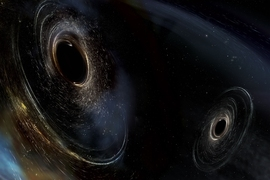 This artist's conception shows two merging black holes similar to those detected by LIGO. The black holes are spinning in a nonaligned fashion, which means they have different orientations relative to the overall orbital motion of the pair. LIGO found hints that at least one black hole in the system called GW170104 was nonaligned with its orbital motion before it merged with its partner.
