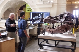 Researchers demonstrate their scanning technique, with a user holding a monopod-mounted Kinect at close range from a T. Rex skull.