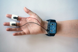 mPath's MOXO sensor, used primarily for market research, is a wearable that resembles a bulky smartwatch. Placed on the wrist, it wirelessly measures changes in skin conductance (subtle electrical changes across the skin), which reflect sympathetic nervous system activity and physiological arousal. Spikes in conductance can signal stress and frustration, while dips may indicate disinterest or bore...
