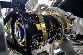 Engineers test one of the TESS cameras at the Kavli Institute lab.