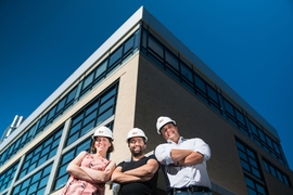 Associate professors Julie Shah, Sertac Karaman, and Amos Winter, in front of the newly renovated Building 31.