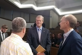 Governor Charlie Baker speaks with conference participants after his keynote address at the 2017 Online Learning Summit.
