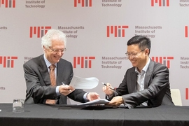 MIT Associate Provost Richard Lester, left, during the launch of the China Future City Lab, Friday, November 17, 2017. Lester welcomed executives from the lab's group of founding partners at a formal signing ceremony.