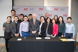 MIT Associate Provost Richard Lester, center left; MIT associate professor Siqi Zheng, the founding faculty member of the China Future City Lab, center right; along with MIT staff and researchers, at the lab's launch event, November 17, 2017.