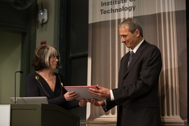 Richard Schrock receives the James R. Killian Jr. Faculty Achievement Award from Susan Silbey, the chair of MIT's faculty.
