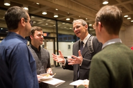 Richard Schrock chats with audience members at a post-lecture reception.