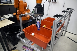 "The ""pick-and-place"" system consists of a standard industrial robotic arm that the researchers outfitted with a custom gripper and suction cup. They developed an ""object-agnostic"" grasping algorithm that enables the robot to assess a bin of random objects and determine the best way to grip or suction onto an item amid the clutter, without having to know anything about the object before pic..."