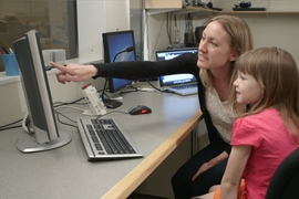 Richardson shows the brain scans to one of the children participating in the study.