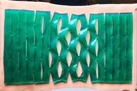 Ruike Zhao, a postdoc in MIT's Department of Mechanical Engineering, says kirigami-patterned adhesives may enable a whole swath of products, from everyday medical bandages to wearable and soft electronics.