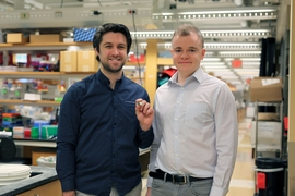 Graduate student Mark Mimee and former MIT postdoc Phillip Nadeau with the ingestible sensor.
