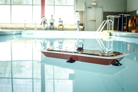 Researchers from MIT's Computer Science and Artificial Intelligence Laboratory (CSAIL) and the Senseable City Lab have designed a fleet of autonomous boats that offer high maneuverability and precise control. The boats can also be rapidly 3-D printed using a low-cost printer, making mass manufacturing more feasible. The boats could be used to taxi people around and to deliver goods, easing stree...