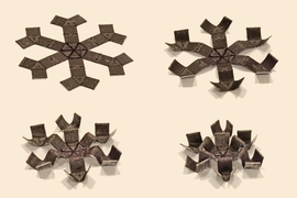The researchers fabricated each structure from a new type of 3-D-printable ink that they infused with tiny magnetic particles.