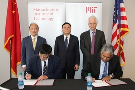 On June 15, 2018, Zhenghe Xu, dean of engineering at SUSTech (seated left) and Anantha Chandrakasan, dean of engineering at MIT (seated right), signed an agreement to establish the Centers for Mechanical Engineering Research and Education at MIT and SUSTech. Standing behind them are Shiyi Chen, president of SUSTech (left), Weizhong Wang, Party Secretary CPC Shenzhen Municipal Committee (center), a...