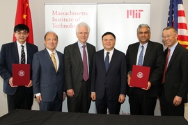 Representatives from MIT, SUSTech, and the Shenzhen government posed after the agreement was signed. From left to right: Zhenghe Xu, SUSTech dean of engineering, Shiyi Chen, president of SUSTech, Richard Lester, associate provost at MIT, Weizhong Wang, Party Secretary CPC Shenzhen Municipal Committee, Anantha Chandrakasan, dean of engineering at MIT and Gang Chen, the Carl Richard Soderberg Profes...