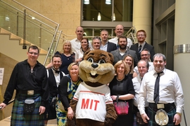 Attendees pose with Tim the Beaver during one of the networking events of the program.