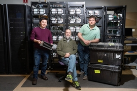 The core team of Haystack scientists who worked on the EHT project stand in front of the correlator at MIT's Haystack Observatory.