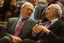Gerald Fink speaks with MIT President L. Rafael Reif before delivering his lecture.