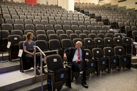 Gerald Fink chats with an early arrival to the Killian Lecture, held in MIT's Room 10-250.