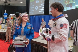 Sophomore Lydia Light, left, prepares her robot for competition, with MechE Associate Professor Amos Winter, right.