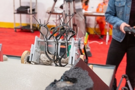 A close-up of sophomore Jessica Xu's robot, Cactus-bot, made from spiky treads designed to scoop up moon rocks.