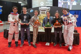 Winter, right, and MechE Associate Professor Sangbae Kim, left, pose with the competition finalists — Sam Ubellacker, (First Place), Dominic Panzino (Second Place), Jessica Xu (Third Place), and Amber Bick (Fourth Place).