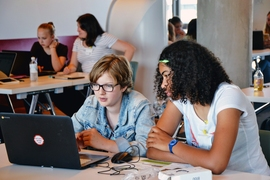 Girls work together to build a mobile app at summer camp