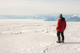 Matt Osman, a graduate student in MIT's Department of Earth, Atmospheric, and Planetary Sciences, overlooking a frozen Baffin Bay to the west, Nuussuaq Peninsula Ice Cap, west Greenland.