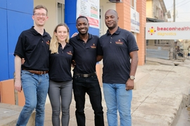 MDaaS Global co-founders in front of their clinic in Ibadan, Nigeria. From left to right: Joe McCord SM '15, Genevieve Barnard Oni MBA '19, Oluwasoga (Soga) Oni SM '16, and Opeyemi Ologun.