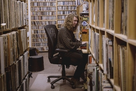 Trevor Henderson in the record library at WMBR, MIT's student radio station.