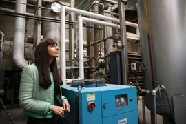 Renewlogy co-founder and CEO Priyanka Bakaya inside one of the company's commercial plants, which are capable of processing ten tons of plastic each day to create about 60 barrels of fuel.