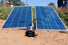The Khethworks system includes a submersible centrifugal solar pump, a controller, and two solar panels. To get the pump running, farmers connect the panels, pump, and controller, then connect the pump to the piping in the field, drop the pump into the water, and flip the on switch.