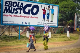 A billboard in Liberia urges people to help stop the spread of Ebola, which was widespread in 2014-2015. A new study shows how a public awareness campaign helped people understand and cooperate with government efforts to control the disease.