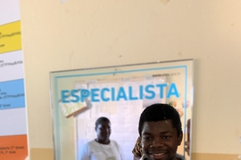 "macro-eyes is working to scale their model's predictive success across all of Tanzania and Mozambique. This photo shows frontline health workers in Mozambique. ""macro-eyes produced mirrors for the health facilities to remind frontline health workers that they are the experts/'Especialistas,'"" Fels says."