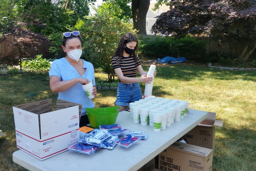 Photo of a woman and a teenage girl assembling boxes of materials