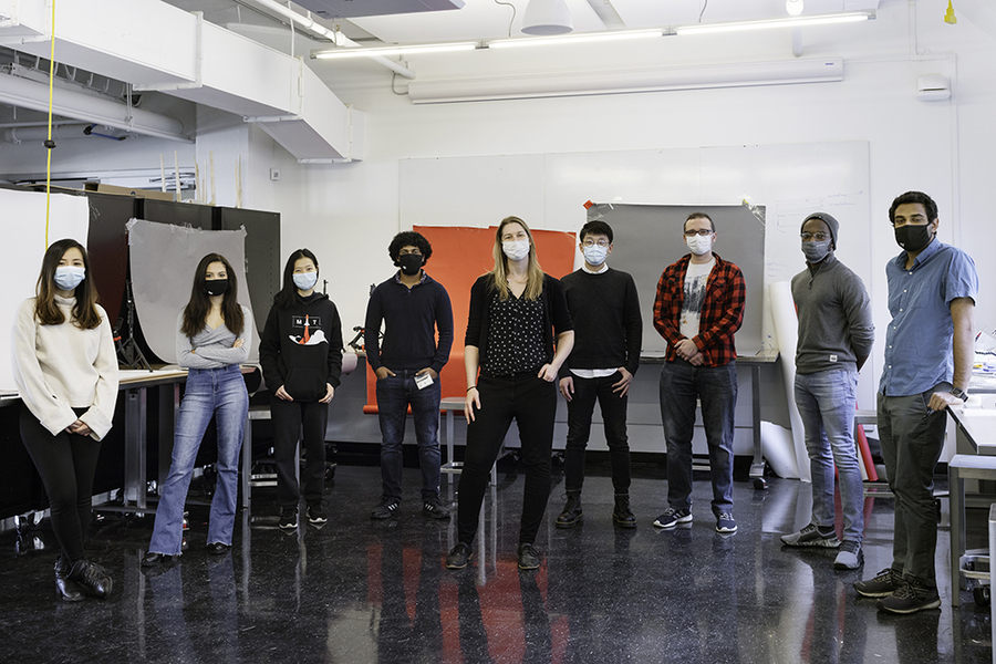 Photo of Professor Mueller and eight students standing in the lab, wearing masks and keeping distance from each other