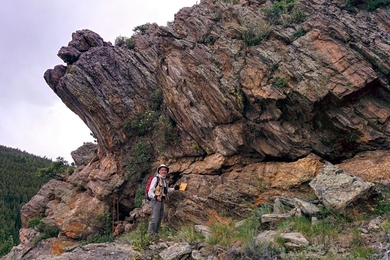 A rock outcrop in Gordon Gulch, Colo., with Stephen Martel of the University of Hawaii pictured in the foreground.