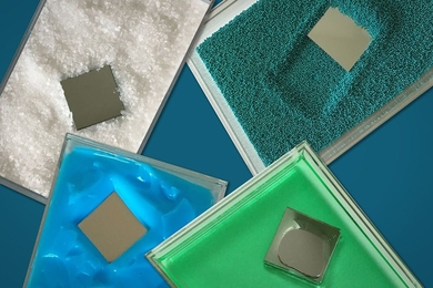 "The photograph shows a square-shaped ""intruder"" plunging through various material, including coarse, salt-like grains (white) and fine sand (blueish green), as well as more viscous (green) and pasty (blue) materials."