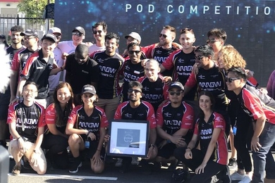 Hyperloop II holding their Innovation Award at the 2019 SpaceX Hyperloop Pod Competition.